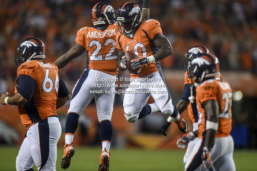 Oct. 23, 2014 - Denver, CO, USA - Denver Broncos running back Juwan Thompson, middle, celebrates a touchdown run with teammate C.J. Anderson (22) against the San Diego Chargers at Sports Authority Field at Mile High in Denver on Thursday, Oct. 23, 2014. The Broncos won, 35-21