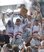 Ernesto Berterelli holds the America's Cup aloft as Alinghi celebrate their clean sweep win of the America's Cup 2003. 2/3/2003 (© Chris Cameron 2003)