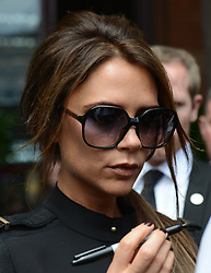Posh Spice Victoria Beckham leaves Viva Forever photocall at St Pancras Hotel in London, Tuesday June 26, 2012 .She also produced Mamma Mia! musical,Photo By Gavin Rodgers/i-Images
