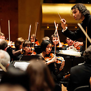 "March 11, 2013 - New York, NY : .Violinist Jeongmin Kim, center, and the London Philharmonic Orchestra, lead by conductor Vladimir Jurowski, top right, perform Gustav Mahler's Symphony No. 5 in C-sharp minor (1901-02), as part of Lincoln Center's ""Great Performers"" series at Avery Fisher Hall on Monday evening..CREDIT: Karsten Moran for The New York Times"