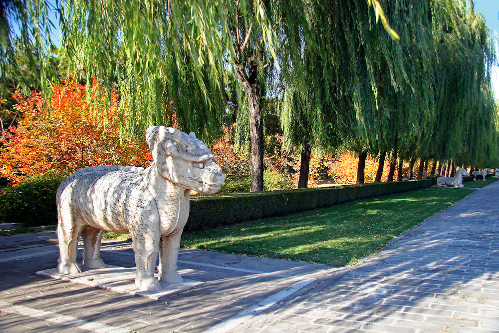 Asia, China, Beijing. A mythical qilin, carved of a single stone, stands guard along the Avenue of the Animals at the Ming Tombs, a UNESCO World Heritage Site.
