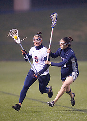 Virginia Cavaliers D Jen Holden (8) runs past Georgetown Hoyas Katie Burton (6).  The Virginia Cavaliers Women's Lacrosse team hosted the Georgetown Hoyas at Klockner Stadium in Charlottesville, VA on April 11, 2007.  UVA lead GU 7-3 with 2:45 remaining in the first half.