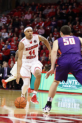 15 January 2016: DeVaughn Akoon-Purcell(44) heads for the paint encountering defender Blake Simmons(50) during the Illinois State Redbirds v Evansville Purple Aces at Redbird Arena in Normal Illinois (Photo by Alan Look)