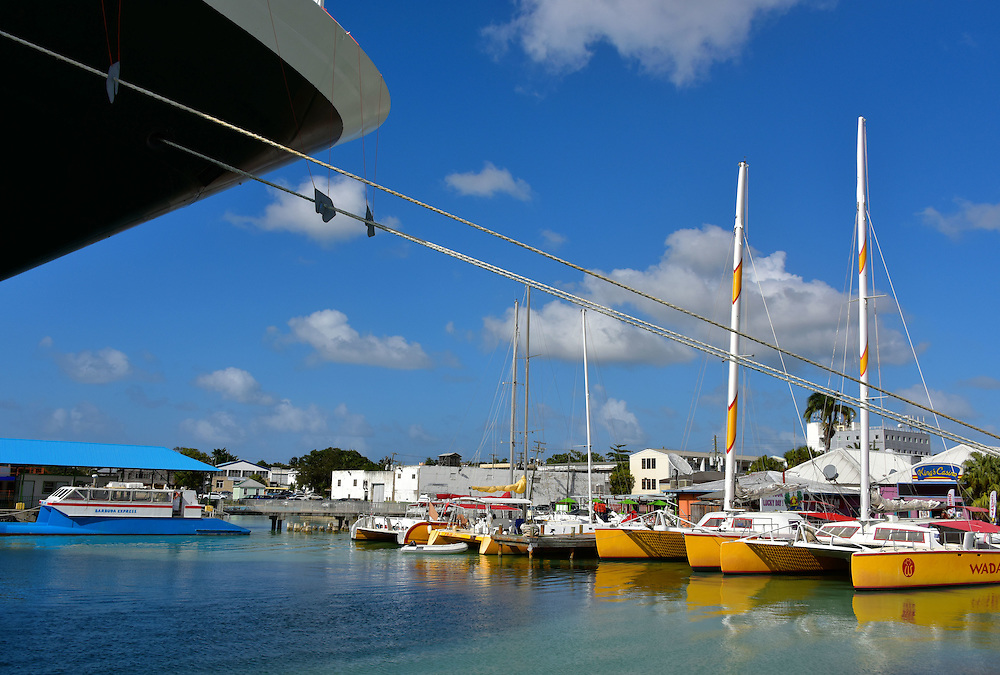 Cruise Ship Bow and Catamarans in St. John&rsquo;s, Antigua<br /> Antigua is only 11 miles wide and 14 miles long but offers 365 beaches and year-round temperatures in the 70s and 80s so it is no surprise that over half of its economy is derived from tourism.  The deep harbor at St. John&rsquo;s welcomes one-day visitors from cruise ships.  Or if you prefer to spend several days basking in the Caribbean sun, then there is an excellent selection of resorts, hotels and cabins to pick from.