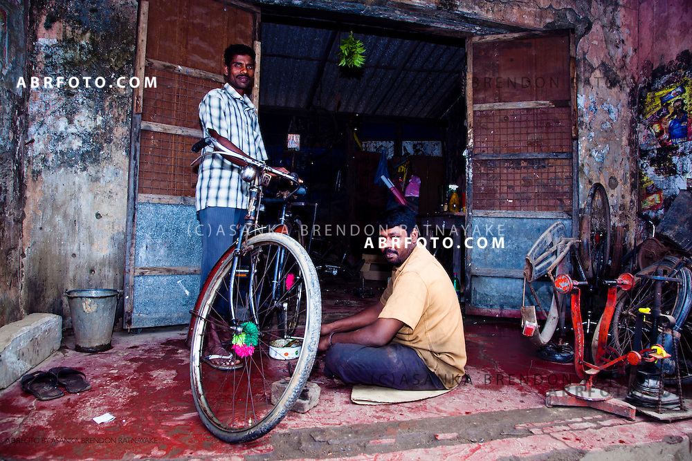 Vendor & bicycle repairer at his shop in Jaffna town.