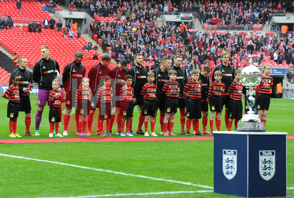 Wrexham players line up ahead of FA Trophy Final against North Ferriby United - Photo mandatory by-line: Paul Knight/JMP - Mobile: 07966 386802 - 29/03/2015 - SPORT - Football - London - Wembley Stadium - North Ferriby United v Wrexham - FA Trophy