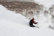 Alex Yoder, heelside with speed in the Moiwa backcountry. Niseko, Hokkaido, Japan.