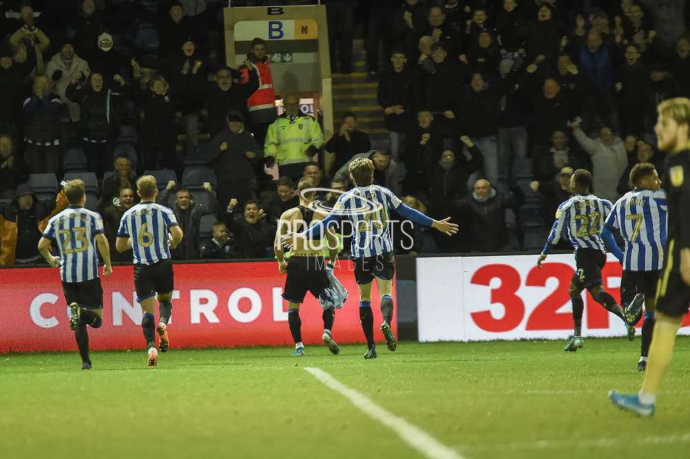 The Sheffield Wednesday players join Steven Fletcher of Sheffield Wednesday in celebrating their teams second goal and taking the lead during the EFL Sky Bet Championship match between Sheffield Wednesday and Brentford at Hillsborough, Sheffield, England on 7 December 2019.