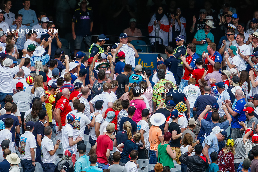 A member of the Victorian police is presented with a shirt by the Barmy army during day 5 of the 2017 boxing day test.