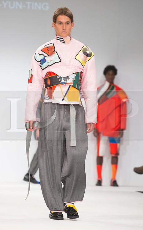 © Licensed to London News Pictures. 02/06/2015. London, UK. Collection by Chou-You-Ting of Shih Chien University. Samsonite International Catwalk Competition takes place during Graduate Fashion Week 2015. Graduate Fashion Week takes place from 30 May to 2 June 2015 at the Old Truman Brewery, Brick Lane. Photo credit : Bettina Strenske/LNP