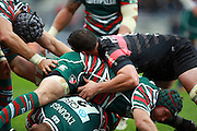 Toby Youngs of Leicester is buried beneath his team mate and Louis Picamoles of Toulouse during the Heineken Cup match between Stade Toulouse and Leicester Tigers at Stade Municipal on October 14, 2012 in Toulouse, France.  Eoin Mundow/Cleva Media