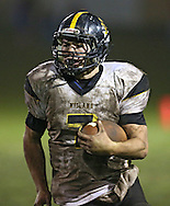 Midland's Ryan Leonard (7) on a run during their game at Allison Field in Springville on Friday October 19, 2012. Midland defeated Springville 30-29.