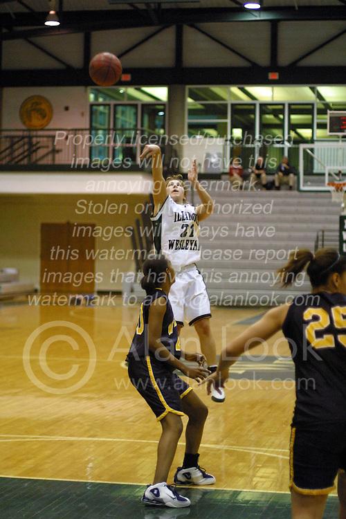 18 December 2004..Gorlocks Rachel Lee leaves Hannah Meharry open for a 3 point shot...Illinois Wesleyan University Titans V Webster University Gorlocks.  NCAA Division III Women's Basketball.  Shirk Center, Illinois Wesleyan University, Bloomington IL