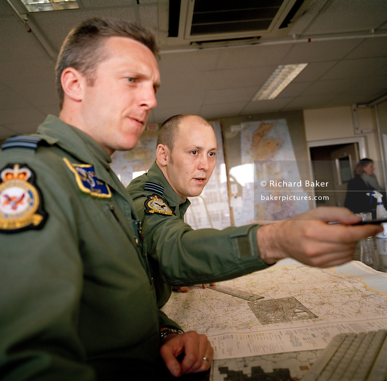RAF fighter pilots prepare for sortie flight at crew briefing room RAF Wittering.