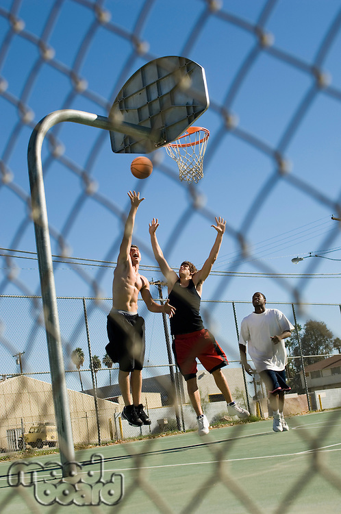 Group of young men playing basketball
