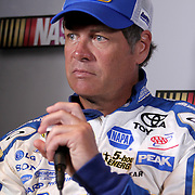 Michael Waltrip speaks with the media during the NASCAR Media Day event at Daytona International Speedway on Thursday, February 14, 2013 in Daytona Beach, Florida.  (AP Photo/Alex Menendez)