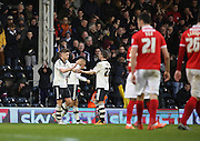 Fulham midfielder, Tom Cairney (10) celebrating scoring his second and Fulham third during the Sky Bet Championship match between Fulham and Charlton Athletic at Craven Cottage, London, England on 20 February 2016. Photo by Matthew Redman.
