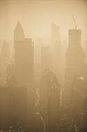 A view from the Oriental Pearl Tower of the skyline of the Huangpu side of Shanghai, China.  Air pollution, particularly from SO2 is a major problem in Shanghai.  Most of the pollution comes from coal-burning smoke and vehicle emissions.