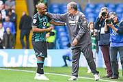 Marcelo Bielsa of Leeds United (Manager) greets Swansea City forward Andre Ayew (22) during the EFL Sky Bet Championship match between Leeds United and Swansea City at Elland Road, Leeds, England on 31 August 2019.