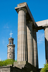 The Nelson Monument on left and National Monument on Calton Hill in Edinburgh, Scotland, United Kingdom