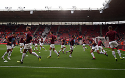Burnley players warm up prior to kick-off