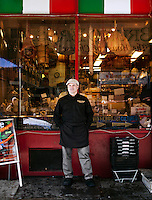 Emilio Mignucci, the third generation owner of Di Bruno Bros., stands outside the company's original South Philadelphia storefront, which is located in the Italian Market neighborhood.