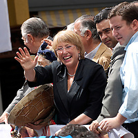 Temuco ,Chile 06 January 2006<br /> Chile's presidential candidate Michelle Bachelet of the Socialist Party and pro-government coalition salutes supporters during a political meeting. <br /> Photo: Ezequiel Scagnetti