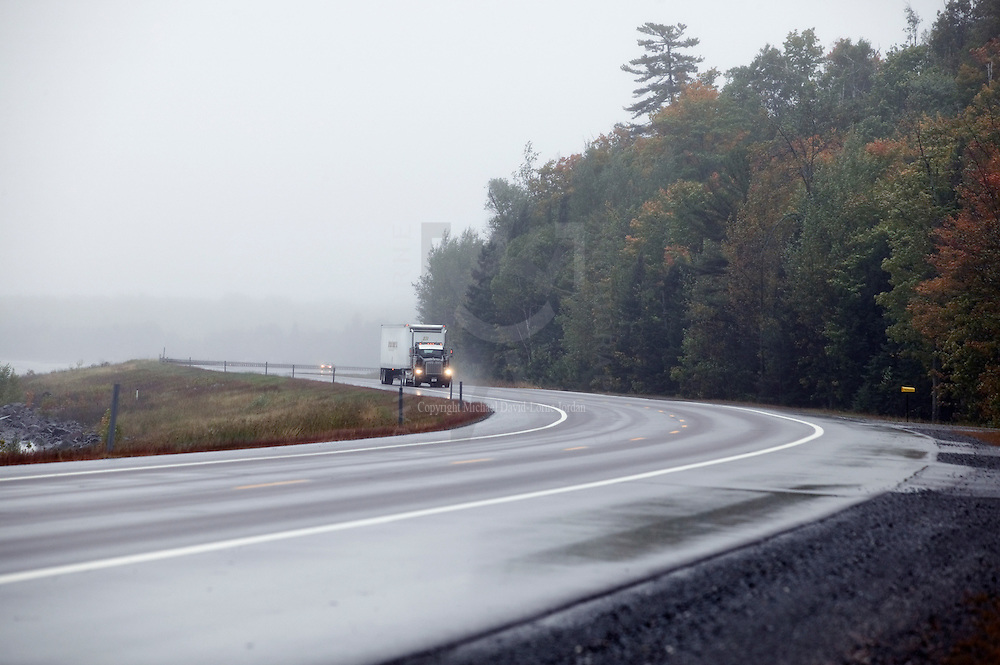 Dark,misty, and rainy road, Michigan's Upper Peninsula.