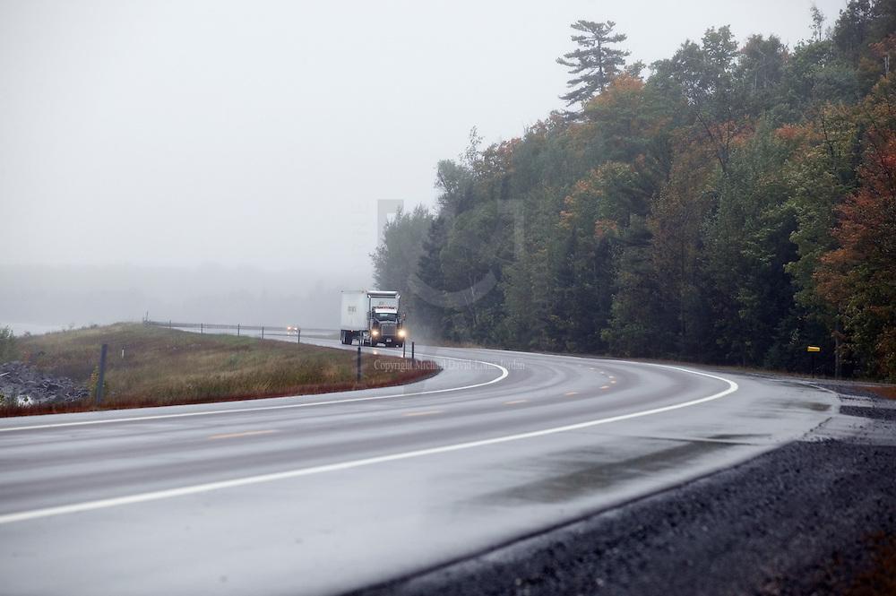 Dark,misty, and rainy road, Michigan's Upper Peninsula.