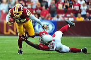 Washington Redskins wide receiver Santana Moss brings in a pass over Arizona Cardinals' Patrick Peterson during the fourth quarter in Washington on September 18, 2011. The Redskins defeated the Cardinals 22-21. UPI/Kevin Dietsch
