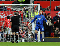 Tomasz Kuszczak is shown the Red Card by Referee Martin Atkinson for fouling Portsmouth's Milan Baros<br /> Manchester United 2007/08<br /> Manchester United V Portsmouth (0-1) 08/03/08<br /> The FA Cup 6th Round<br /> Photo Robin Parker Fotosports International