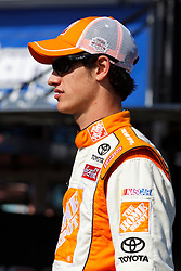 June 25, 2011; Sonoma, CA, USA;  NASCAR Sprint Cup Series driver Joey Logano (20) walks to his car during practice for the Toyota/Save Mart 350 at Infineon Raceway.