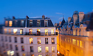 Apartments are illuminated at dusk in the Sorbonne district of Paris.