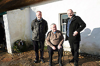 28/03/2016  RnaG presenter (retired) Frainc a'mhaille from Ros Muc (seated)Pictured with Eoin Mac Lochlainn great grandnephews of Patrick Pearse at Pearse's Cottage, Teach an Phiarsaigh, in Rosmuc in Connemara during a special broadcast of RT&Eacute; Raidi&oacute; na Gaeltachta programme Adhmhaidin on Easter Monday 28 March 2016.  <br /> <br /> Patrick Pearse used the cottage as a summer house, and also as summer school for his pupils from St Enda&rsquo;s school in Dublin.  He was inspired by the people and the culture of the area, and it is said that he composed the graveside oration he gave at O&rsquo;Donovan Rossa&rsquo;s funeral in 1915 there.<br /> <br /> The broadcast was to commemorate the centenary of the Easter Rising, and also marked 30 years on air for the programme.  <br /> Photo:Andrew Downes, xposure.
