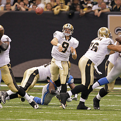 2009 September 13: New Orleans Saints quarterback Drew Brees (9) throws during a 45-27 win by the New Orleans Saints over the Detroit Lions at the Louisiana Superdome in New Orleans, Louisiana.