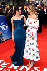 Lily James (right) and Jessica Brown Findlay (left) attending the world premiere of The Guernsey Literary and Potato Peel Pie Society at the Curzon Mayfair, London. Photo credit should read: Doug Peters/EMPICS Entertainment