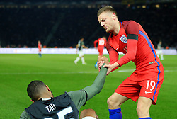 Englands Jamie Vardy helps up Germanys Jonathan Tah - Mandatory by-line: Matt McNulty/JMP - 26/03/2016 - FOOTBALL - Olympiastadion - Berlin, Germany - Germany v England - International Friendly