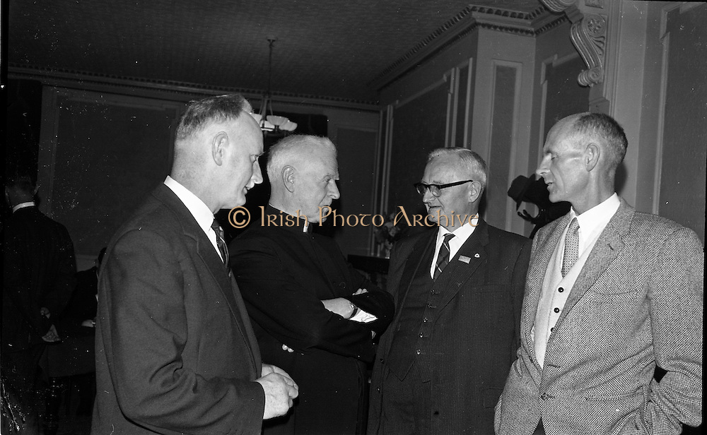 21/09/1963<br /> 09/21/1963<br /> 21 September 1963<br /> Annual general meeting of St. Brendan's College Union (Dublin Branch) at Jury's Hotel, Dublin. Picture shows (l-r): Commandant B. Houlihan; Most Rev. Dr. D. Moynihan, Bishop of Kerry; J.J. O'Sullivan and Miceal O'Suilleabhain.