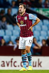 Joe Cole of Aston Villa is challenged by Jay Simpson of Leyton Orient - Photo mandatory by-line: Rogan Thomson/JMP - 07966 386802 - 27/08/2014 - SPORT - FOOTBALL - Villa Park, Birmingham - Aston Villa v Leyton Orient - Capital One Cup Round 2.