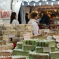 VENICE, ITALY - DECEMBER 08:  Two stall holders sell Christmas nougat at a Christmas Market on December 8, 2011 in Venice, Italy. HOW TO LICENCE THIS PICTURE: please contact us via e-mail at sales@xianpix.com or call our offices in London   +44 (0)207 1939846 for prices and terms of copyright. First Use Only ,Editorial Use Only, All repros payable, No Archiving.© MARCO SECCHI
