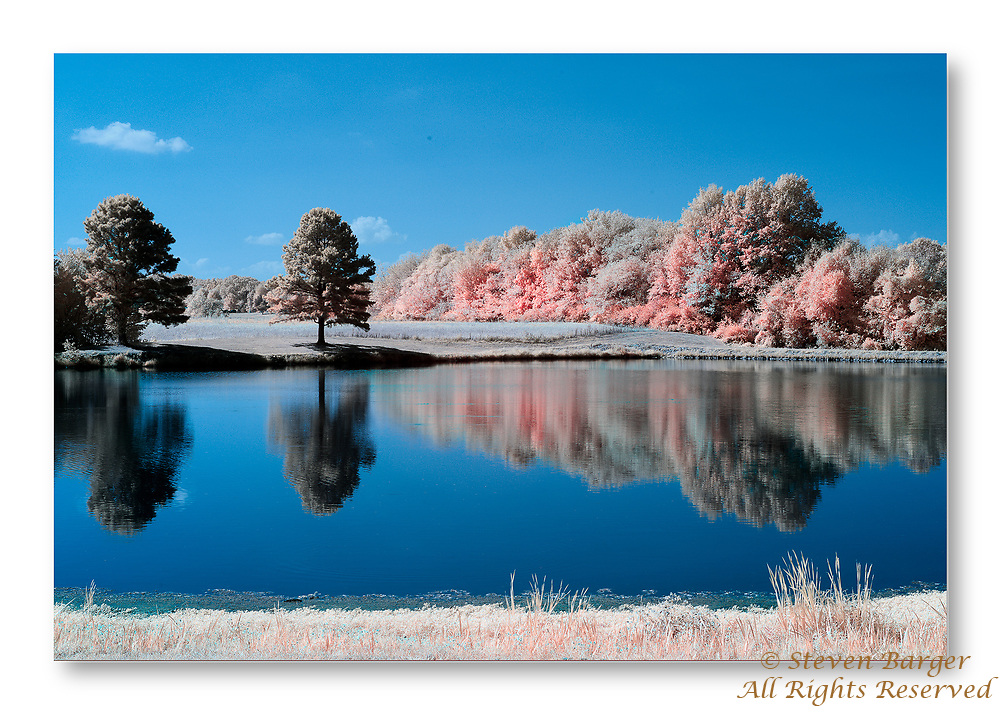 Reflections on Veterna's Memorial Lakeview Park lake in Waterloo, Illinois captured with digital camera converted for infrared