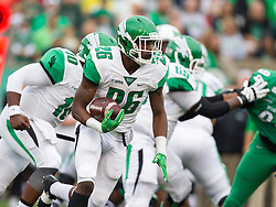 Oct 24, 2015; Huntington, WV, North Texas Mean Green running back Jeffrey Wilson runs the ball during the first quarter at Joan C. Edwards Stadium. Mandatory Credit: Ben Queen-USA TODAY Sports