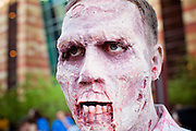 27 MAY 2011 - PHOENIX, AZ: Zac Weitzel, from Mesa, AZ, participates in the Zombie Walk in Phoenix Friday. Phoenix Comicon opened Thursday and featured a Zombie Walk through downtown Phoenix Friday night. Hundreds of people participated in the Zombie Walk, both as Zombies and as Zombie hunters. This year's Comicon includes appearances by Leonard Nimoy (Star Trek), Adam Baldwin (Firefly and Chuck), Stan Lee (Marvel Comics), Nicholas Brendon (Buffy the Vampire Slayer) and others. Activities include costuming workshops, role playing games and a Geek Prom.     Photo by Jack Kurtz