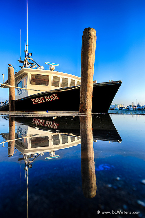 Reflection of a blue sky and fishing trawler in Wancheese North Carolina.