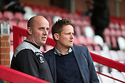Portsmouth manager Paul Cook and AFC Wimbledon manager Neal Ardley during the Sky Bet League 2 match between AFC Wimbledon and Portsmouth at the Cherry Red Records Stadium, Kingston, England on 26 April 2016.