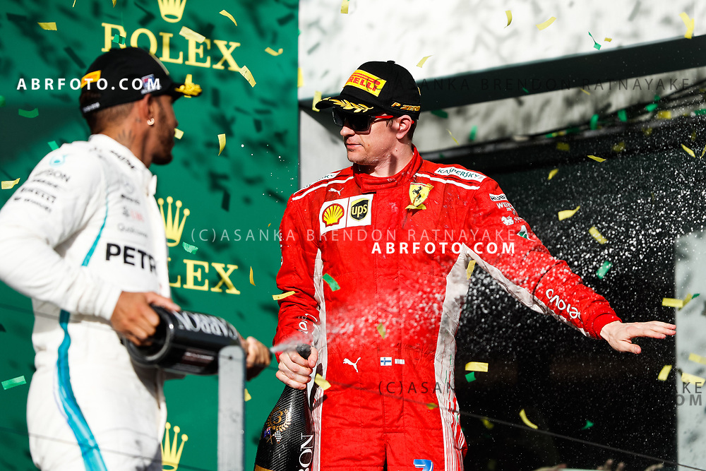 Ferrari driver Kimi Raikkonen of Finland gets sprayed with champagne on the podium during the trophy presentation at the end of the 2018 Rolex Formula 1 Australian Grand Prix at Albert Park, Melbourne, Australia, March 24, 2018.  Asanka Brendon Ratnayake