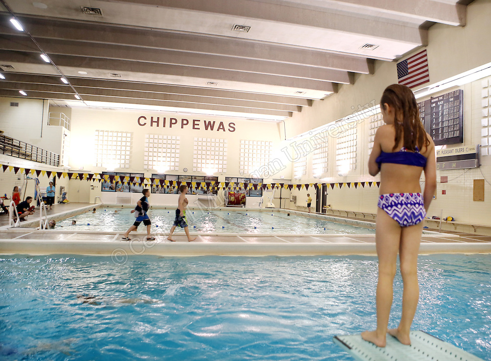 A girl waits to jump off the diving board in Rose Pool during recreation time for Grandparents U photo by Emily Mesner