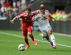 West Bromwich Albion's Cristian Gamboa battles for the ball with Swansea City's Jefferson Montero - Photo mandatory by-line: Alex James/JMP - Mobile: 07966 386802 30/08/2014 - SPORT - FOOTBALL - Swansea - Liberty Stadium - Swansea City v West Brom - Barclays Premier League
