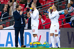 England Head Coach Gareth Southgate speaks to Eric Dier of England and Jordan Henderson of England - Mandatory by-line: Robbie Stephenson/JMP - 15/11/2018 - FOOTBALL - Wembley Stadium - London, England - England v United States of America - International Friendly