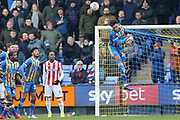 28 Josh Laurent for Shrewsbury Town heads a cross clear during the The FA Cup 3rd round match between Shrewsbury Town and Stoke City at Greenhous Meadow, Shrewsbury, England on 5 January 2019.